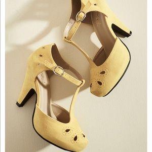 Yellow faux suede retro heels.